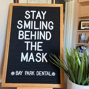 Sign: Stay smiling behind the mask